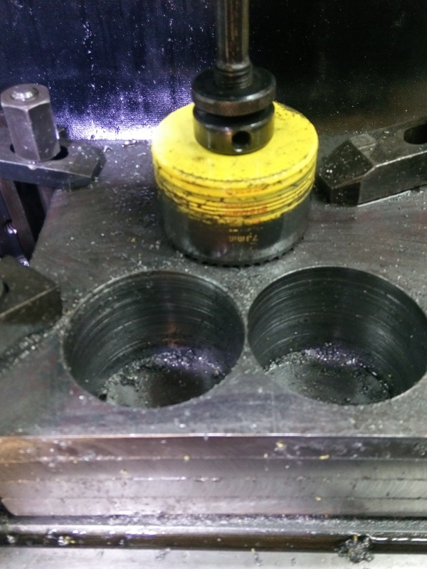 Two 73mm Holes cut into Four 15mm plates sandwich together.