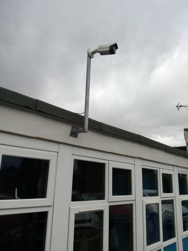 Low roof on a school we made a 2M bracket with a 12 degree pitch to fit the fascia and keep the bracket vertical