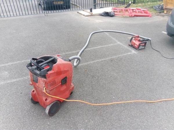 2. Then cut-in with our Hilti floor saw and dump-vac. We clean out with compressed air any stones that have fallen in.